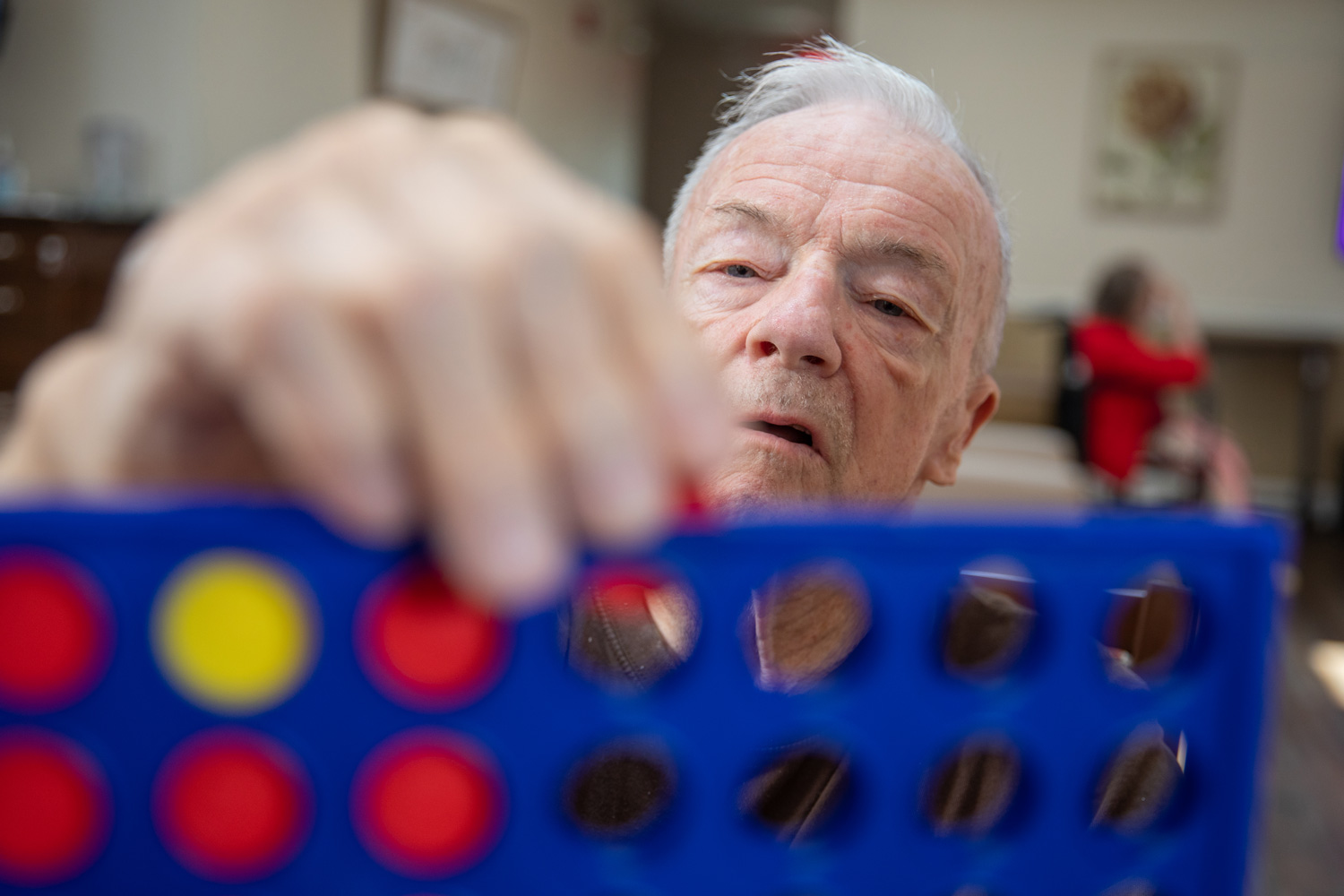 resident playing connect four
