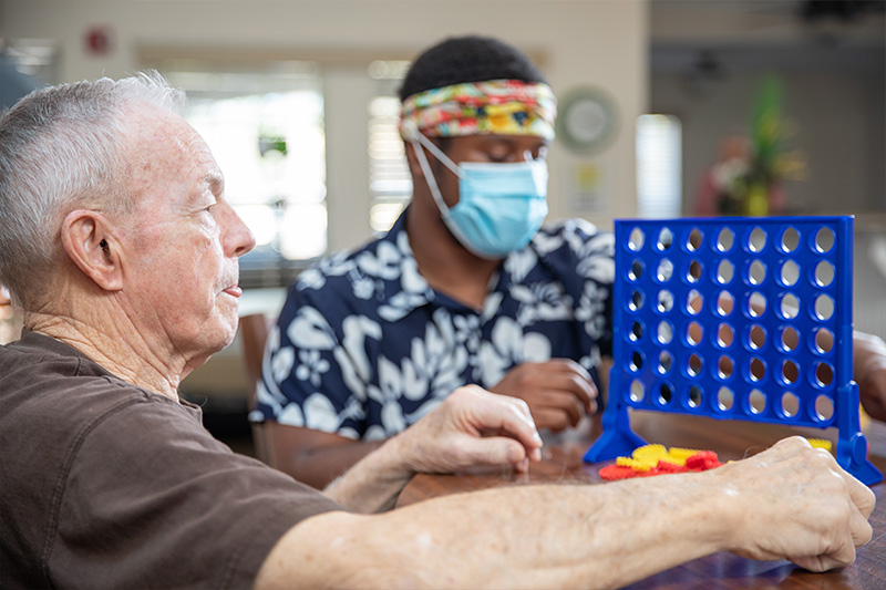 residents playing connect 4