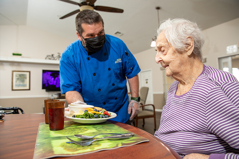 chef serving a resident